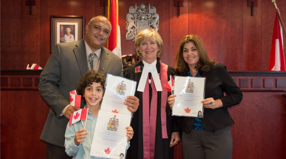 New canadian citizens at a citizenship ceremony dayowlshutterstock