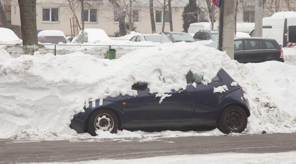 Car parked snowy road shutterstock