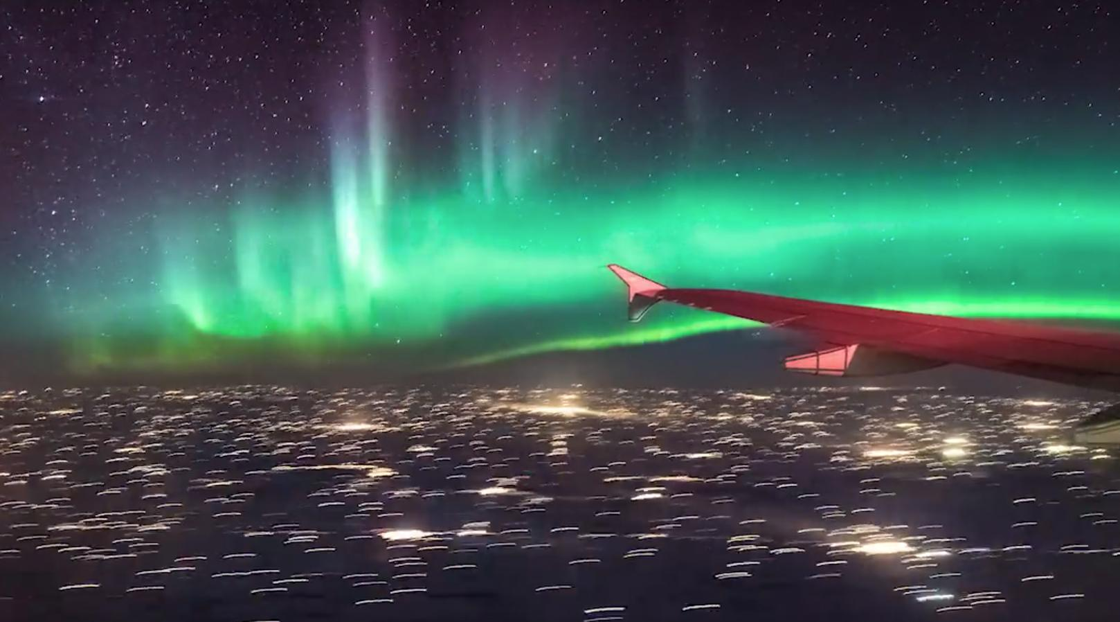 Northern lights timelapse shot from a plane nathan starzynski