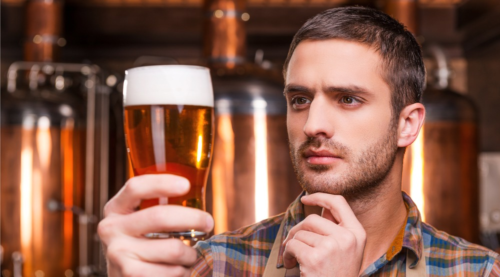 A man and his beer (g-stockstudio/Shutterstock)