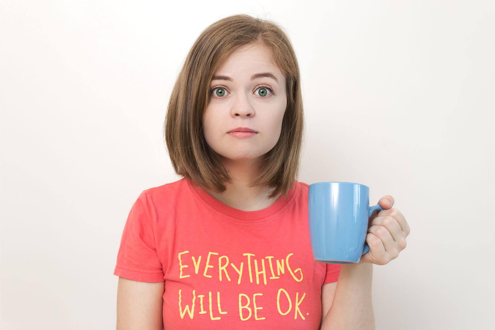Woman drinking tea (aldarinho/Shutterstock)