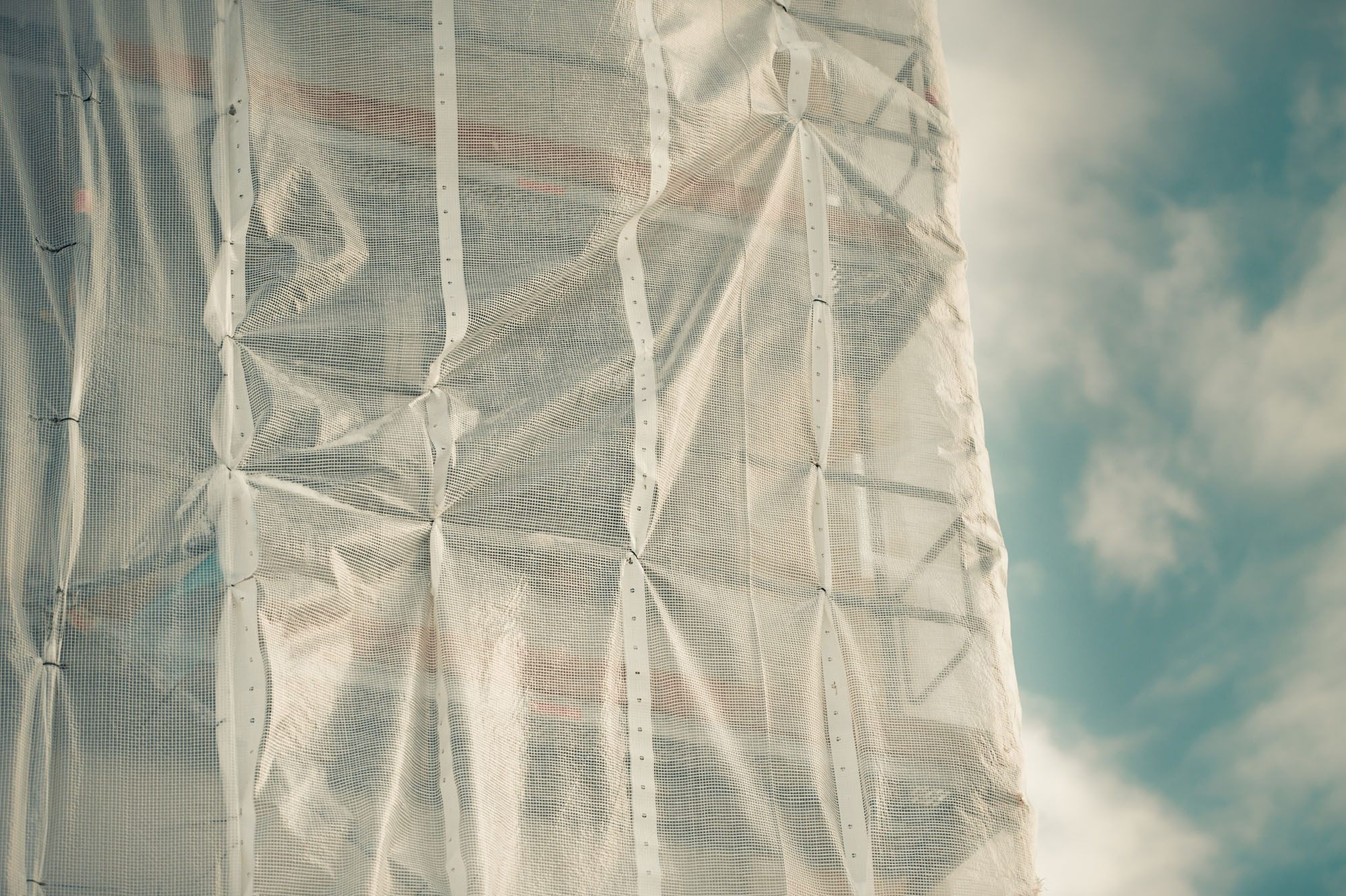 Wrapping around a building being repaired (I. Grasbergs/Shutterstock)