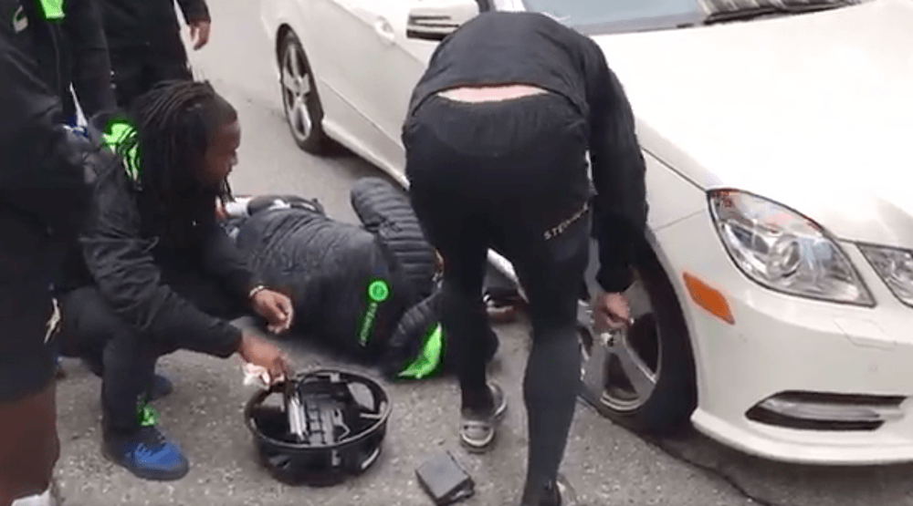 South African rugby team changes stranded Vancouverite's flat tire on way to game (VIDEO)