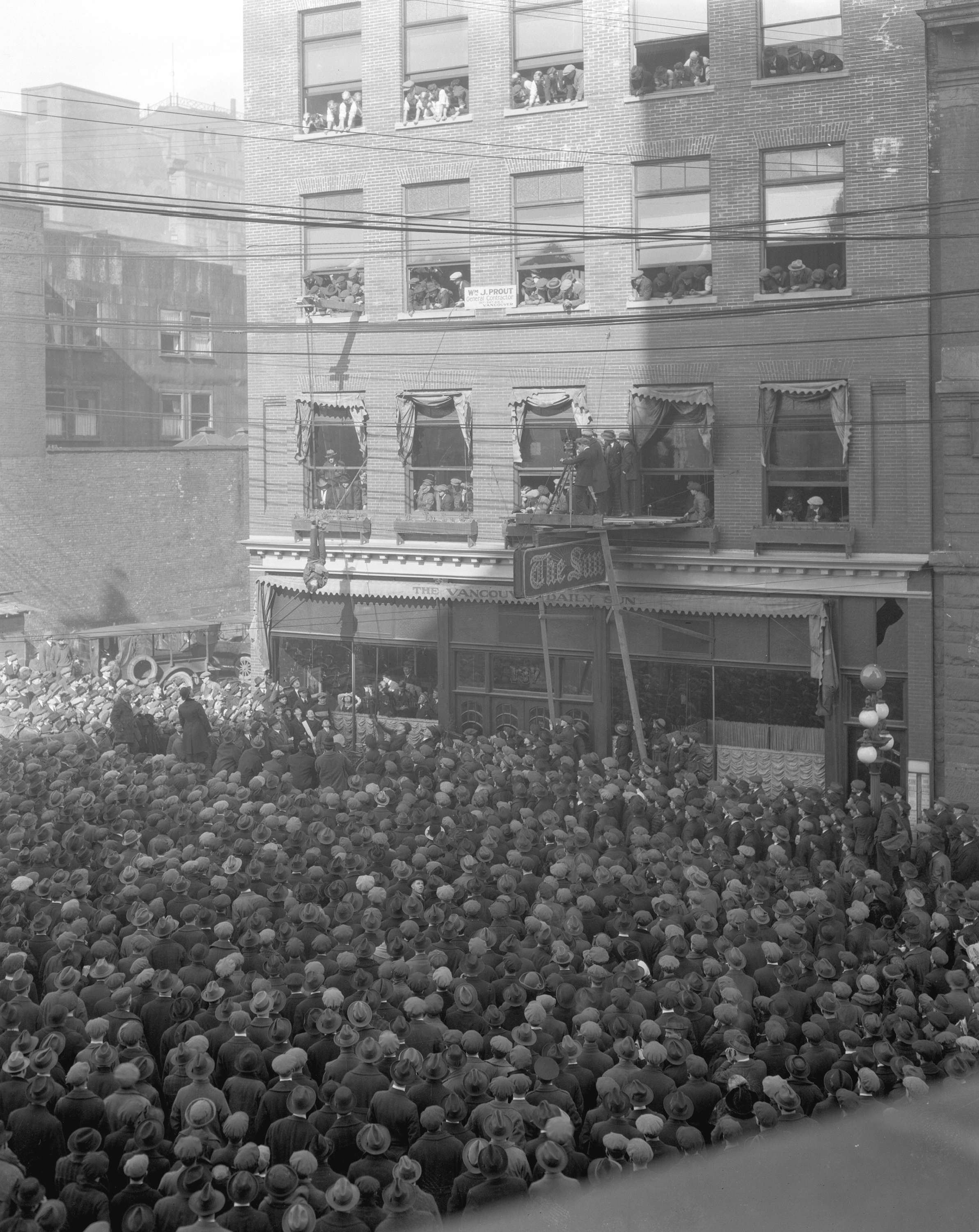 Harry Houdini hanging upside down in Vancouver