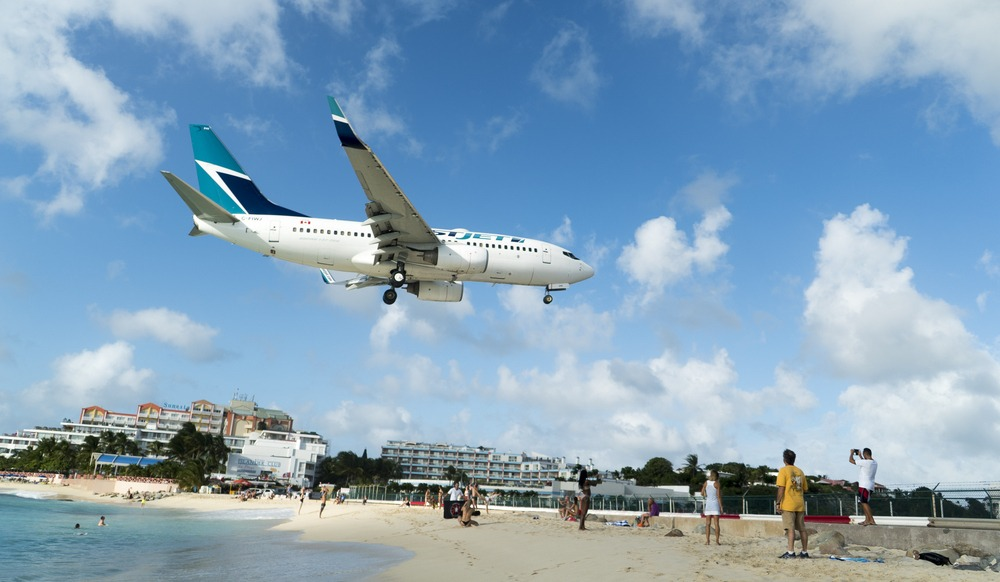 Toronto flight comes very close to water while landing in St. Maarten (VIDEO)
