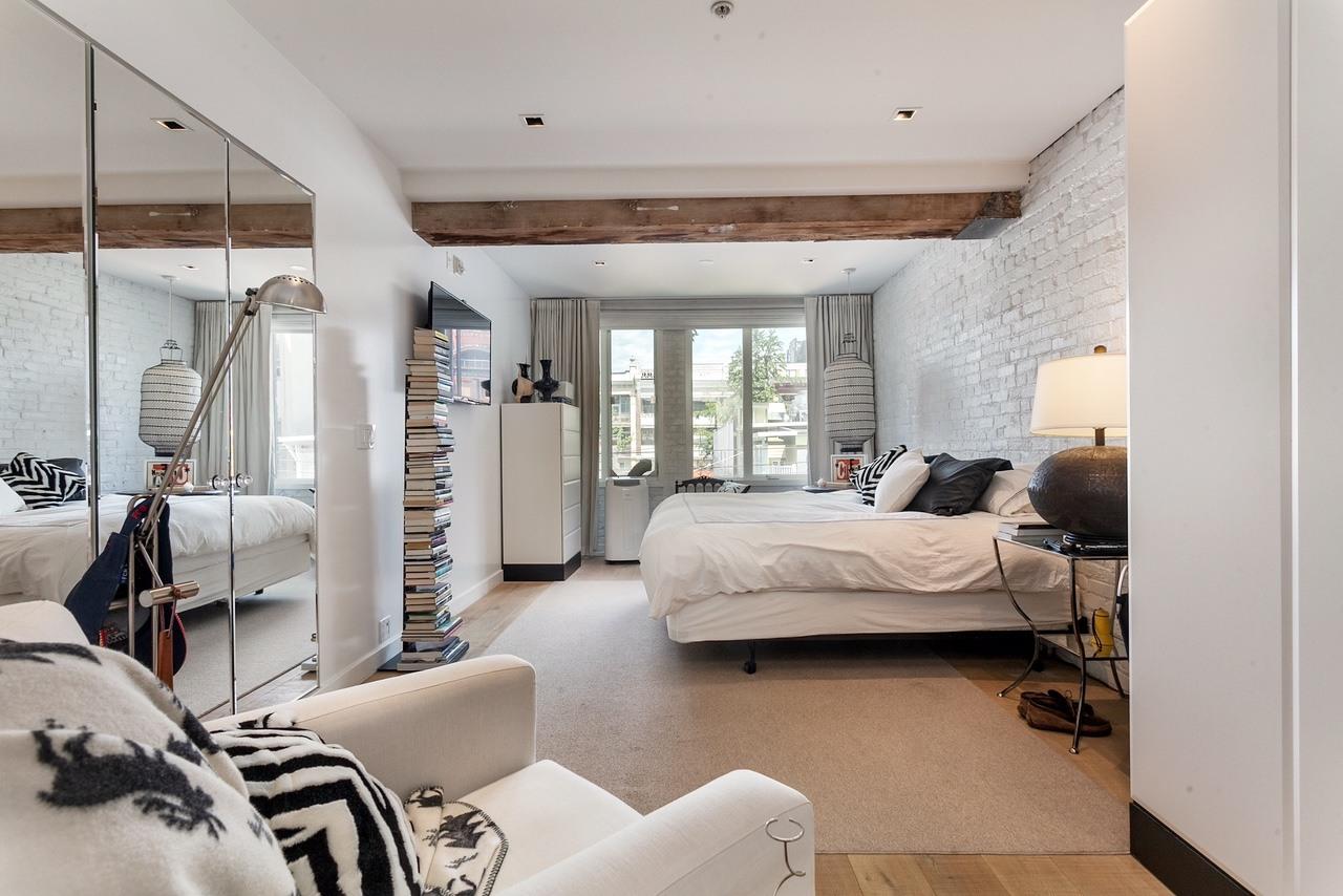 The master bedroom has classy brick walls (Angell Hasman & Associates (Eric Christiansen) Realty Ltd)