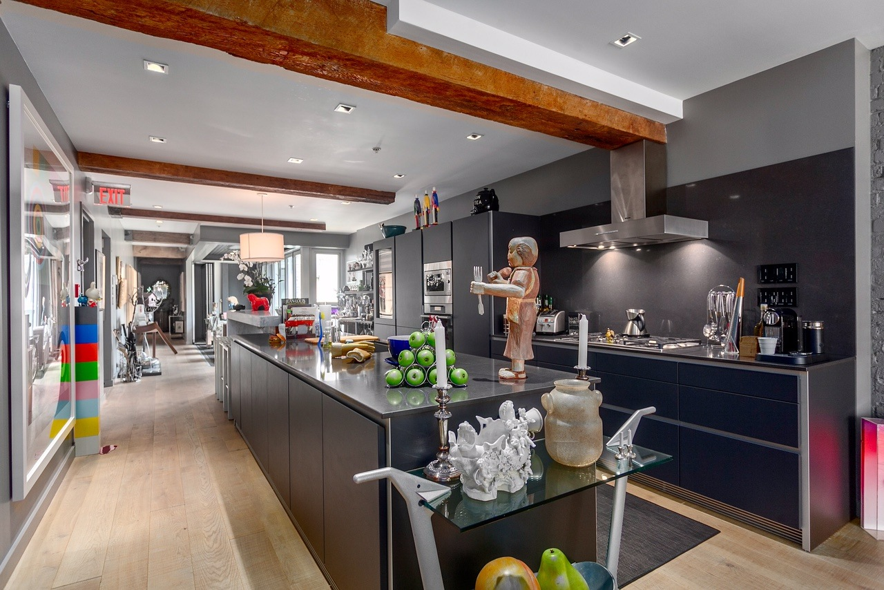 A large island sits in the middle of the kitchen (Angell Hasman & Associates (Eric Christiansen) Realty Ltd)