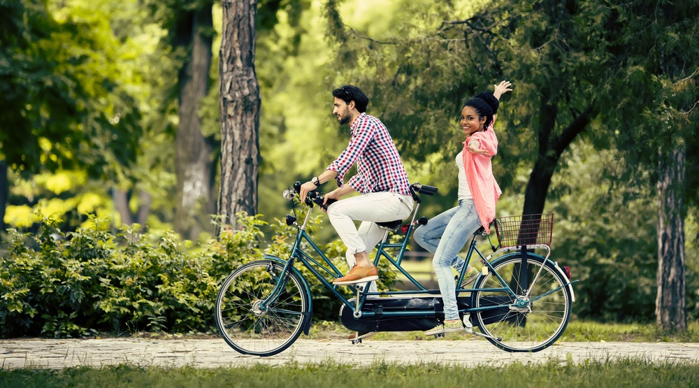 Young couple on tandem bike