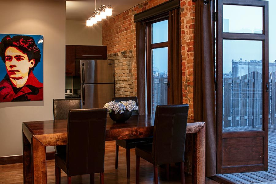 The dining room at the two bedroom penthouse (Hotel Nelligan)