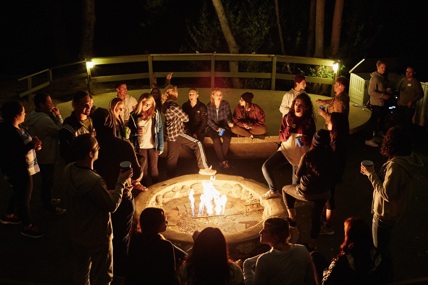 Hanging out by the fire with new friends (Camp No Counselors)