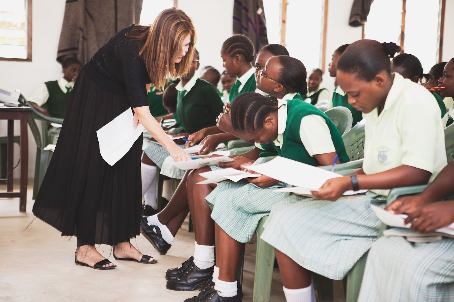 Lotte Davis working with girls in Africa (One Girl Can)