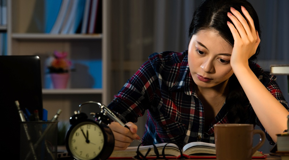 Girl studying at night shutterstock1