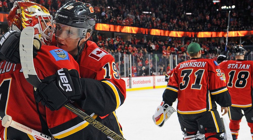 Flames beat Sharks, clinch playoff spot