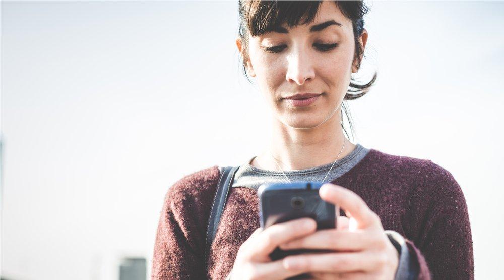 Woman on cellphone shutterstock