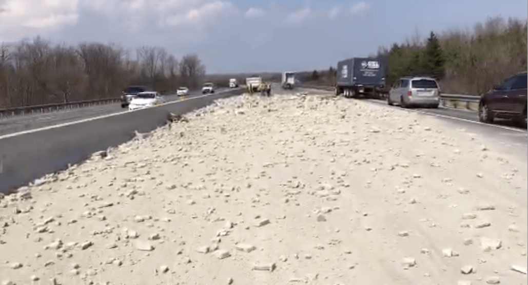 Clean up on Hwy 400 after truck spills concrete across four lanes