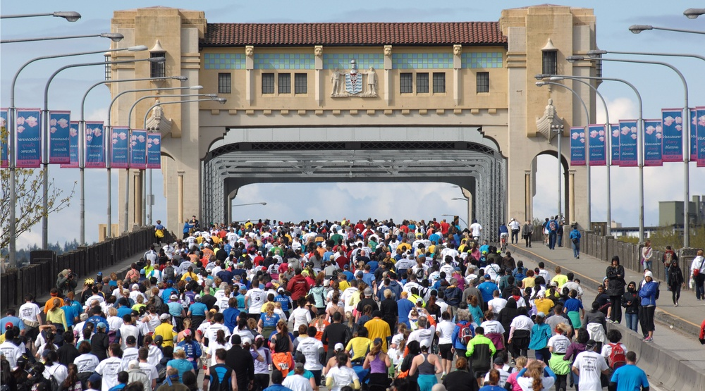 Vancouver sun runners heading over burrard bridge in 2013 sergei bachlakovshutterstock