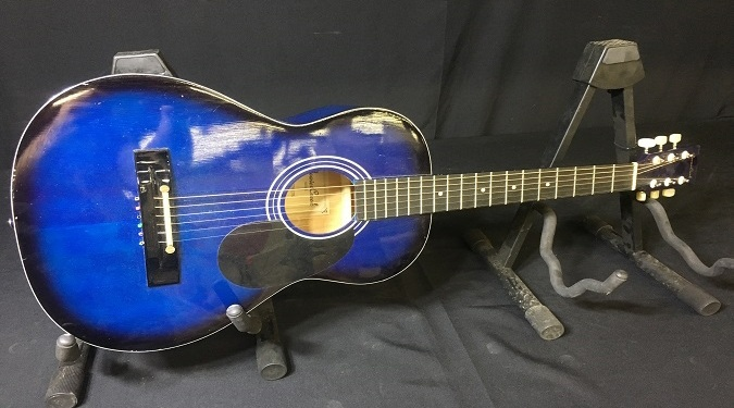 A blue guitar for sale at police auction able auctions