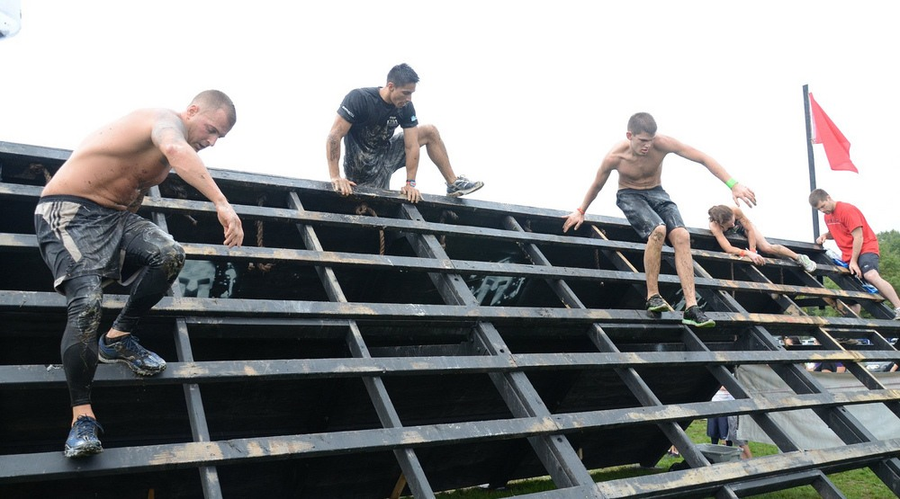 Racers crawl, climb and clamber over Spartan Race obstacles (Edwin Martinez/Flickr)