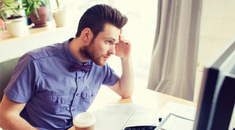 Man bored at work syda productionsshutterstock