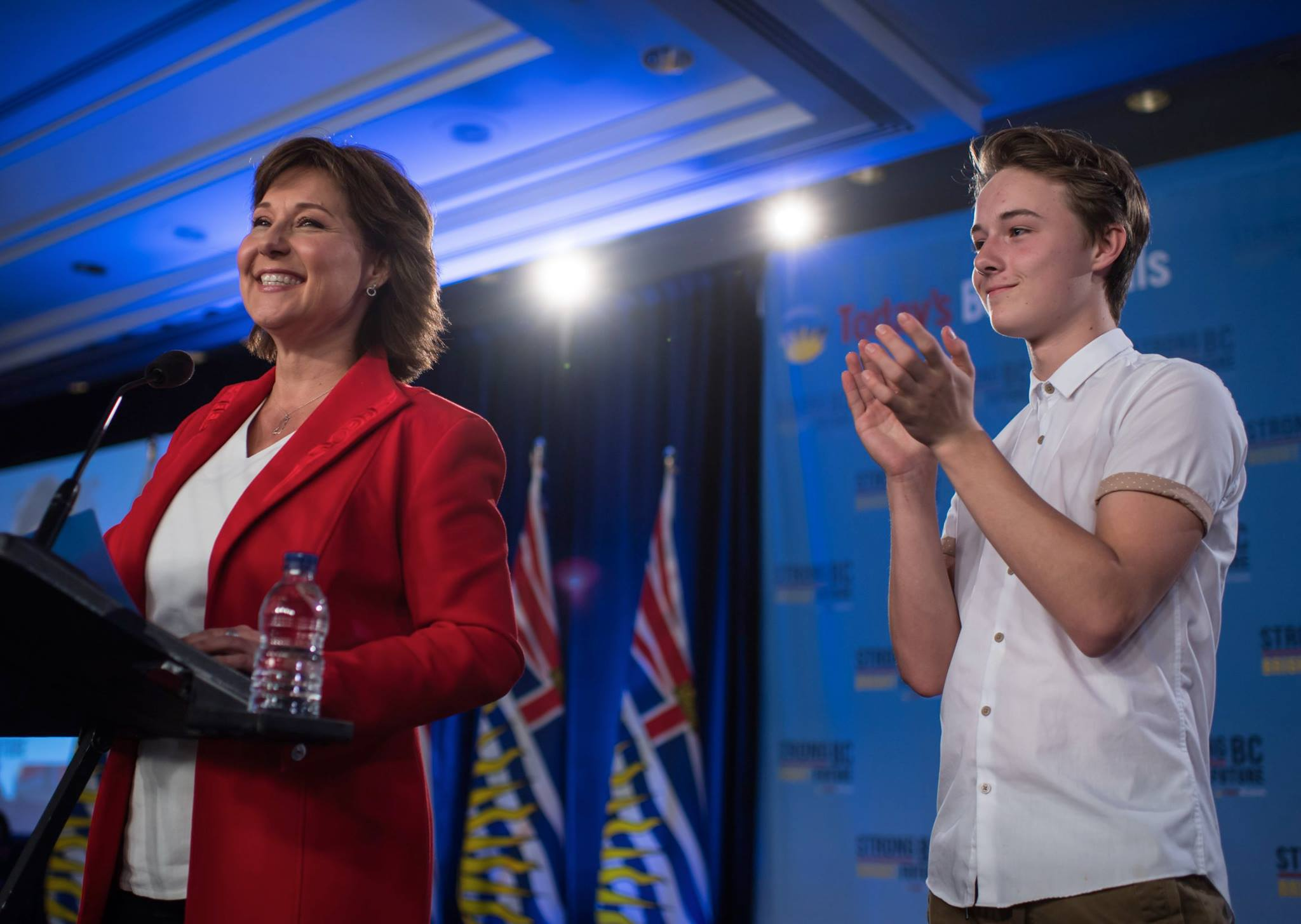 BC Liberals leader Christy Clark giving her election night speech with son Hamish at her side (Christy Clark/Facebook)