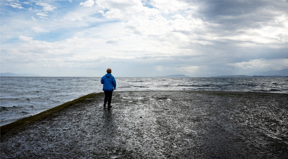 A woman walking on the coast near courtenay and comox on vancouver island shutterstock copy