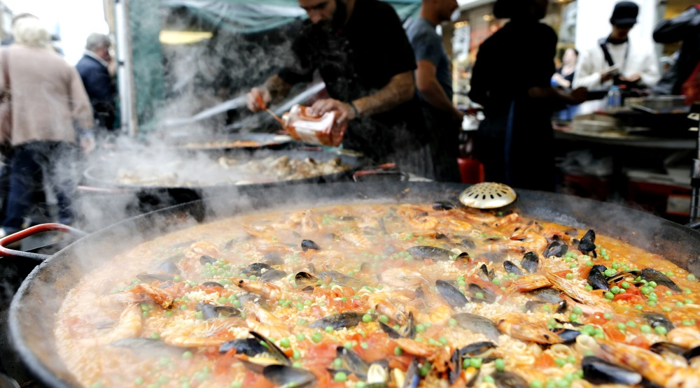 You can get fresh street-side paella on Saint Laurent right now