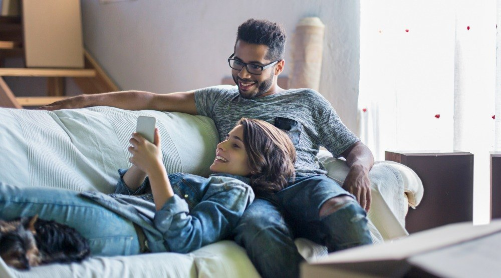 Couple on couch with dog istock 492785834