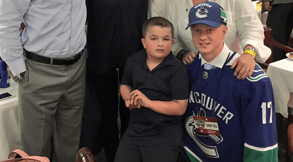 Family decision: Canucks draft pick staying home next season to be with little brother with autism