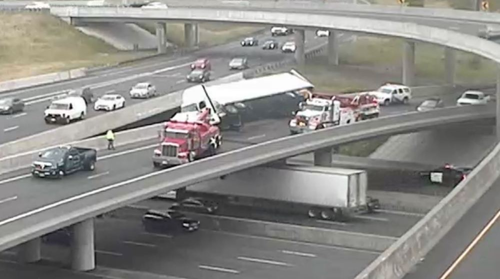 Eastbound Hwy 401 lanes closed this morning after transport truck tipped