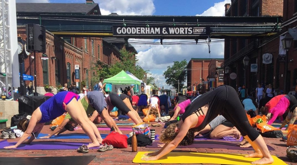 Hundreds took over the Distillery District for day of outdoor yoga (PHOTOS)