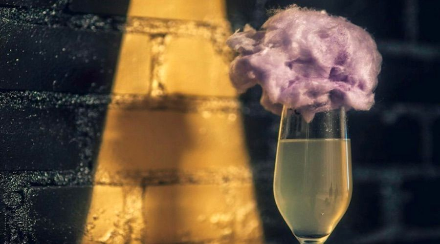 There's a cocktail with bubbly and cotton candy at this sexy new bar