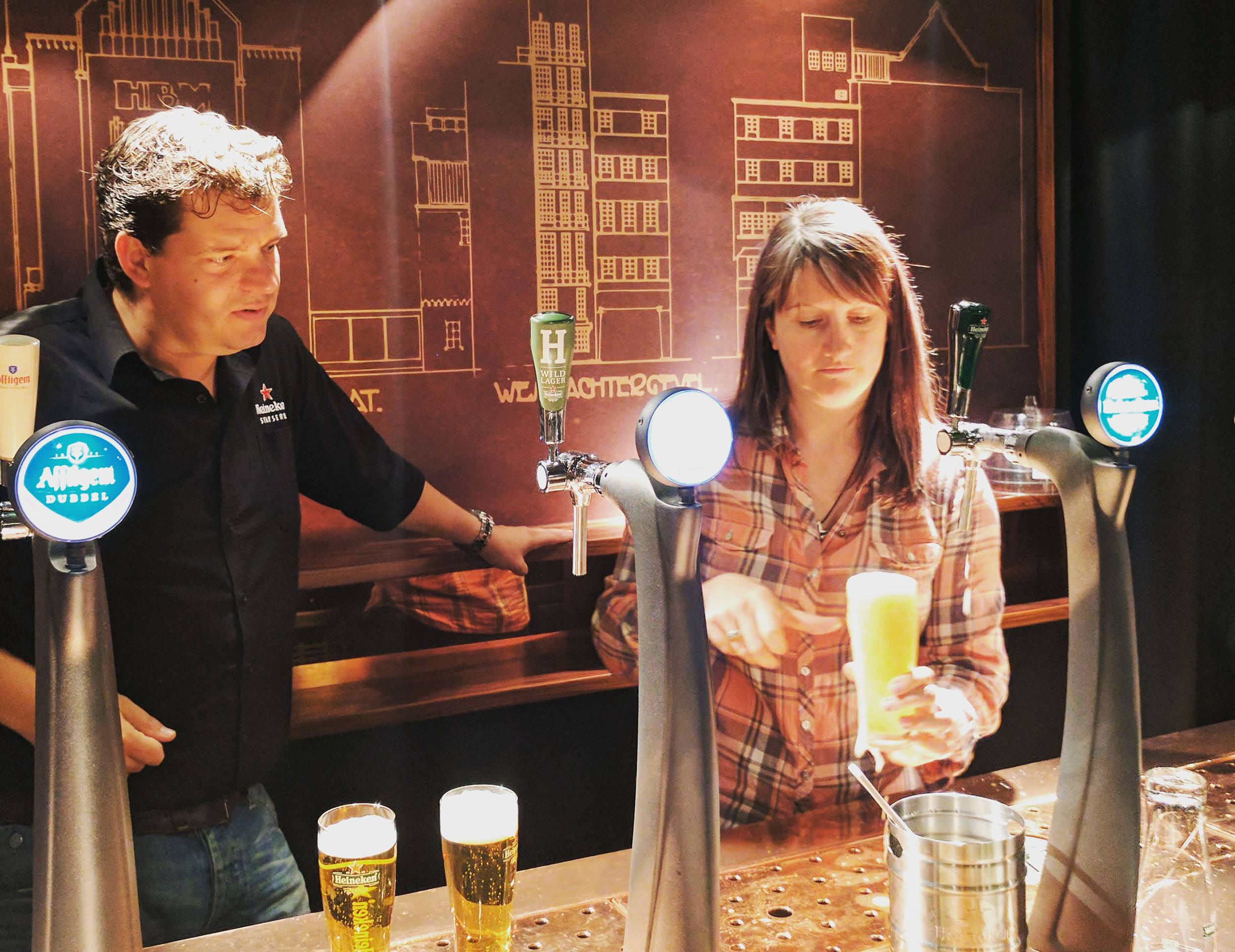 Learning to pour the perfect Heineken with Global Draft Master Laurens Raven at the Heineken Experience in Amsterdam (Jenni Sheppard)