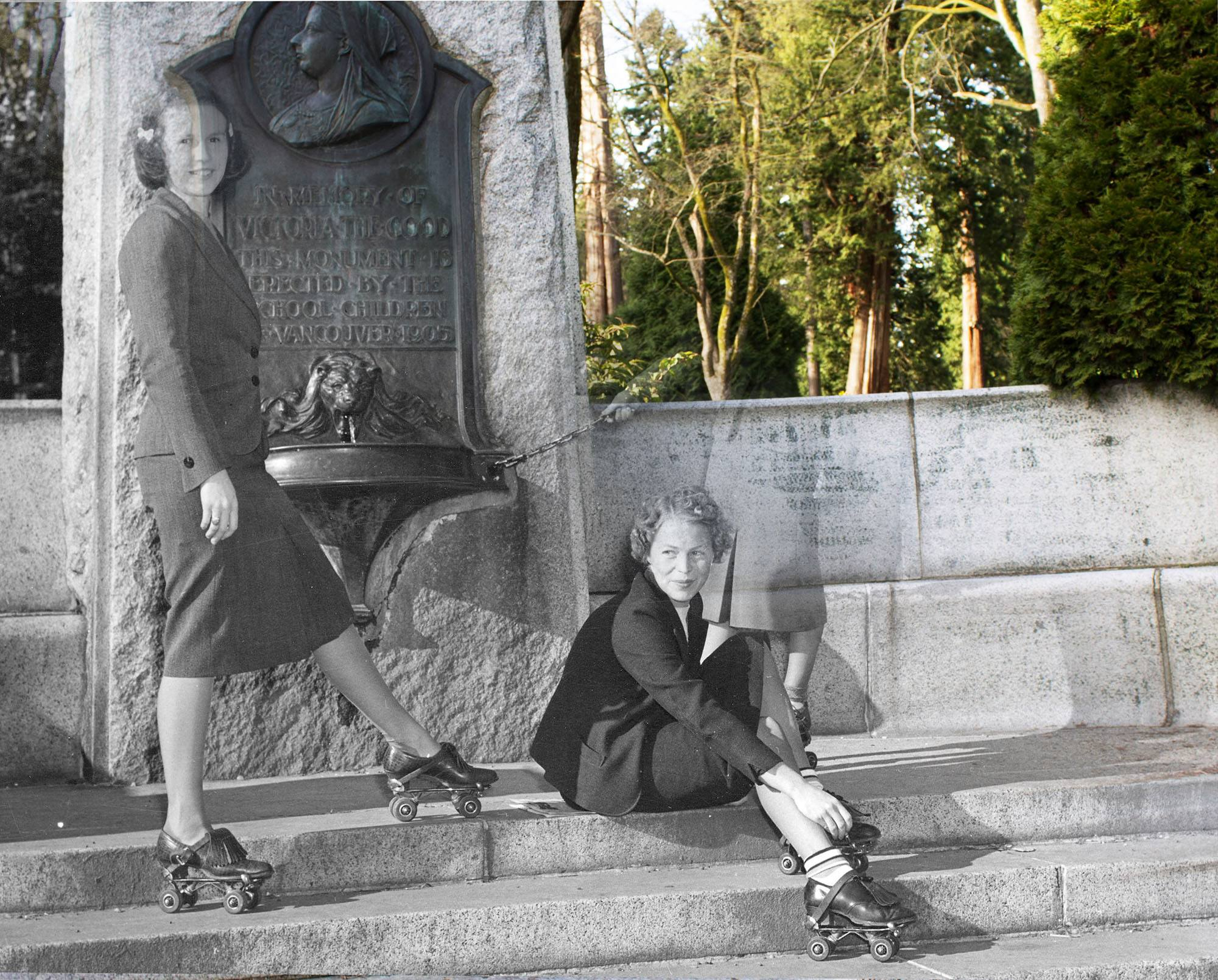 Three smiling girls take a break from roller skating at the Queen Victoria Memorial Fountain in 1940 (Vancouver Archives/On This Spot)