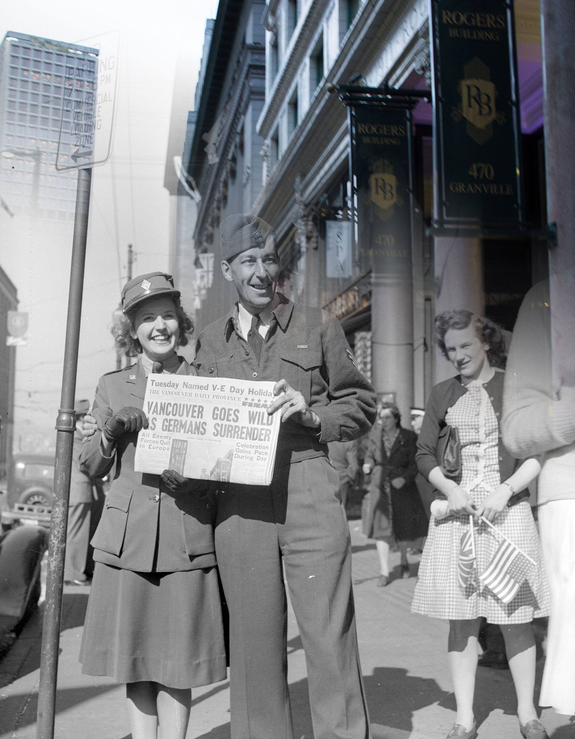 A uniformed man and woman beam as they celebrate Victory in Europe Day in 1945 (Vancouver Archives/On This Spot0