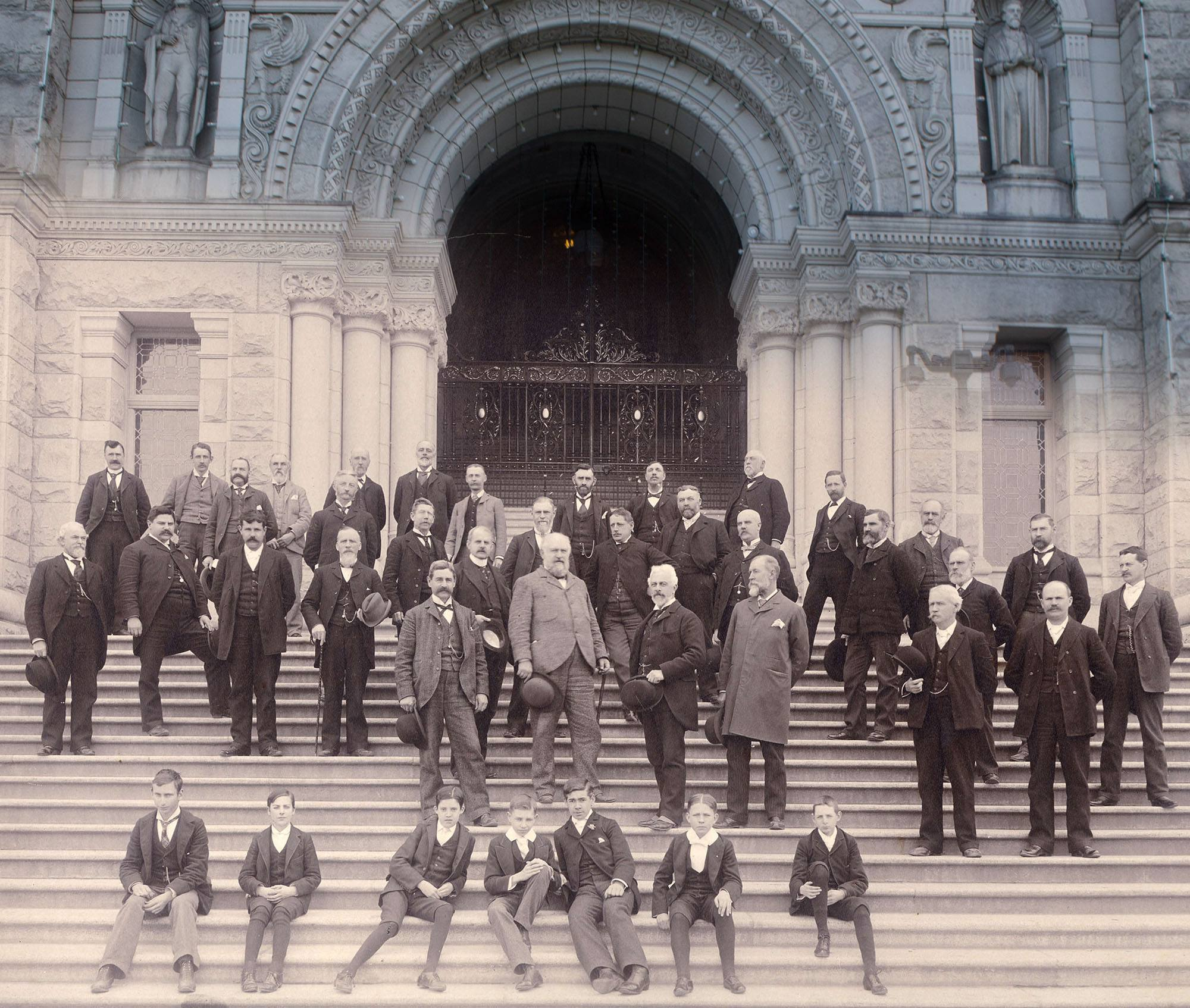 The government of British Columbia on the steps of the BC Legislature in the 1880s (Vancouver Archives)