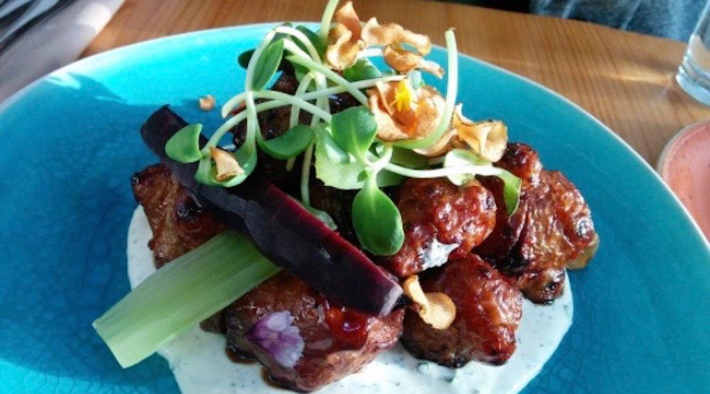 Happy Hours: $5 pints and ciders and a whole whack of featured grub at Nomad