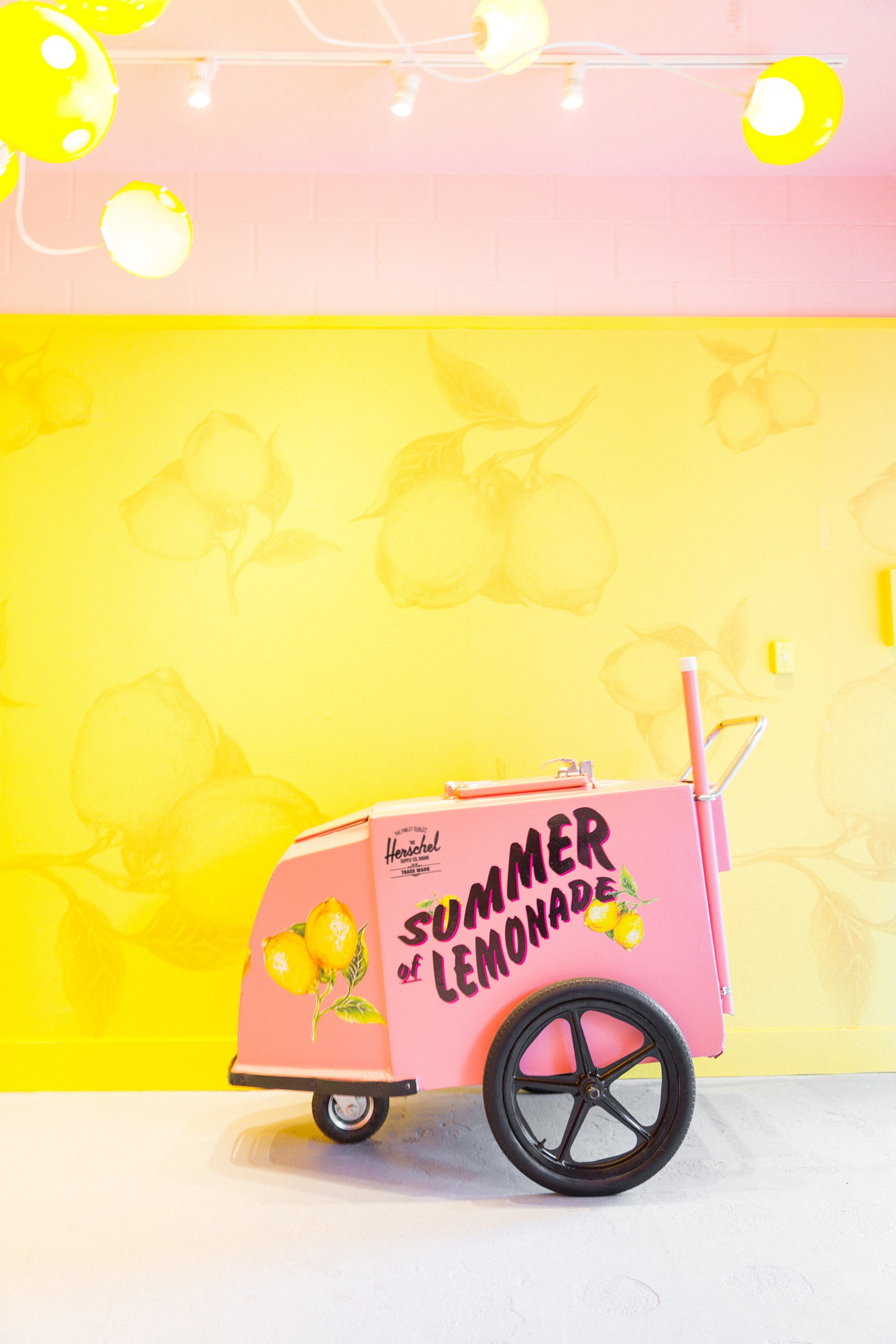 The theme hints on leisurely summer days & childhood lemonade stands. (Herschel Co.)