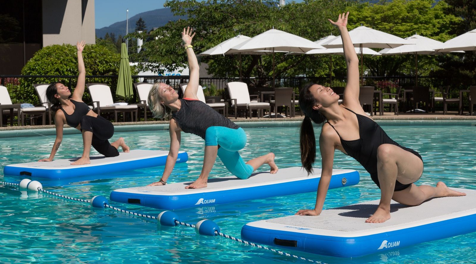 Liquid Yoga on swimming pool inflatables offered at Vancouver hotel