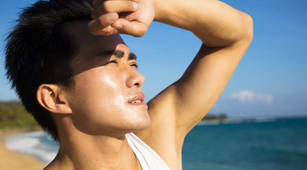 Man in summer sun shutterstock