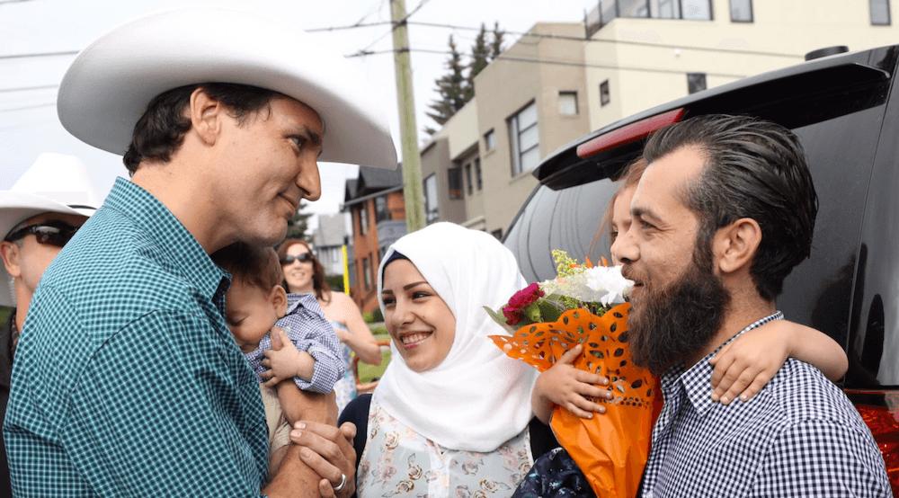 Trudeau with baby trudeau adam scott