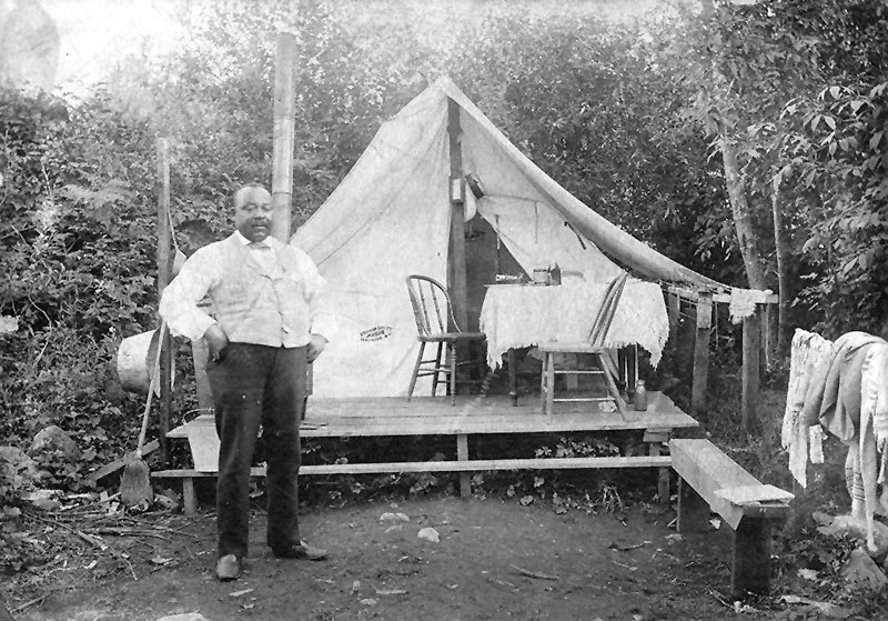 Joe Fortes in front of his tent at English Bay in the 1890s. Later the City would give him a cottage on English Bay. City of Vancouver Archives #Port P1725.