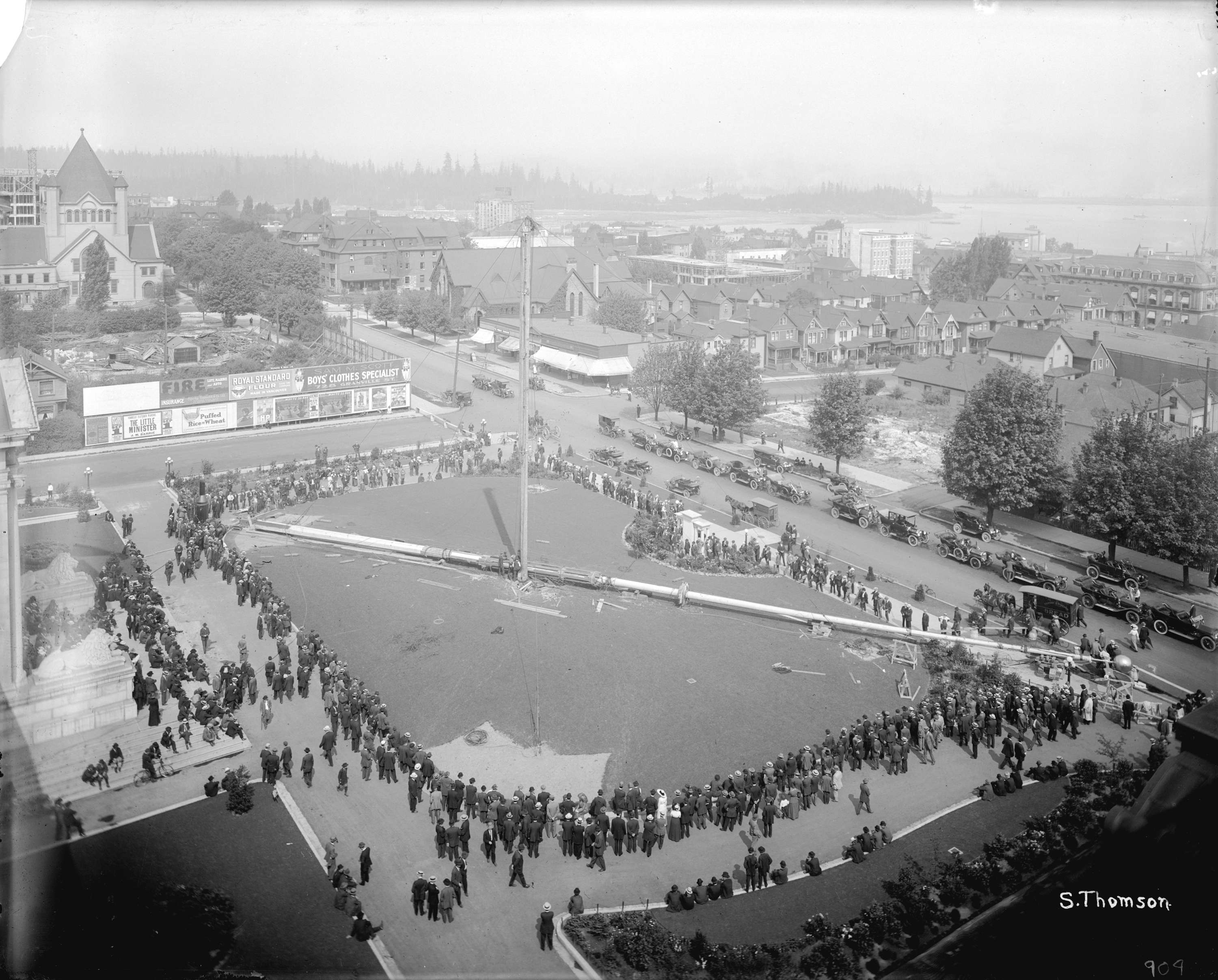 A flagpole being raised in BC courthouse square in Vancouver in 1913 (Vancouver Archives)