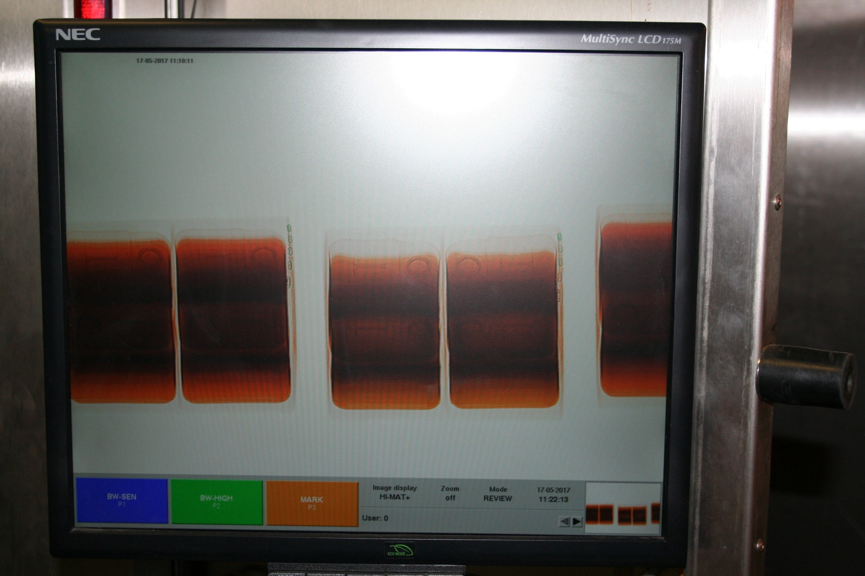 """A scan of the """"dishwasher fluid"""" jugs by the CBSA (CBSA)"""