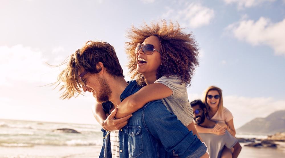 Friends on beach in summer jacob lundshutterstock
