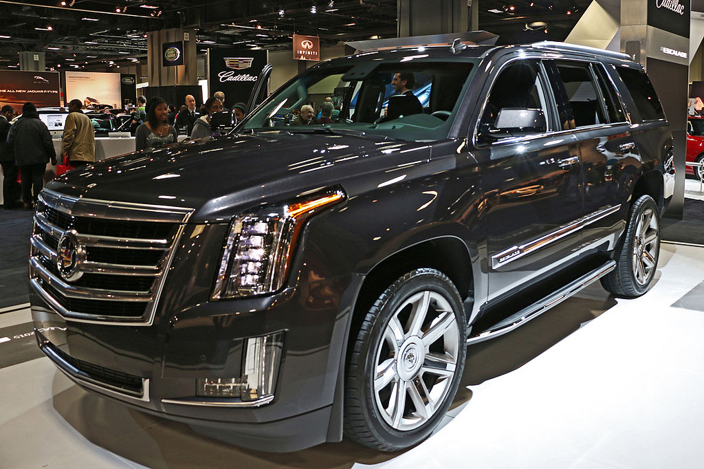 "<a href=""https://en.wikipedia.org/wiki/Cadillac_Escalade#/media/File:1st-Cadillac-Escalade.jpg"">Cadillac Escalade (BrianBoardman from Alexandria VA - 2014 Washington Auto Show)</a>"