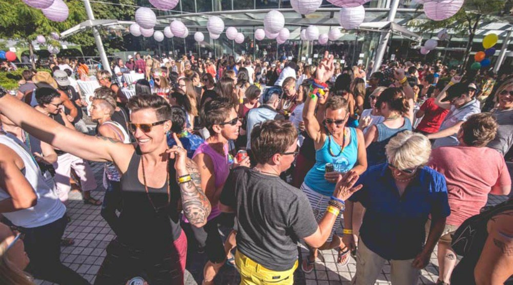 This outdoor Vancouver Pride party has inflatable toys and two dance floors