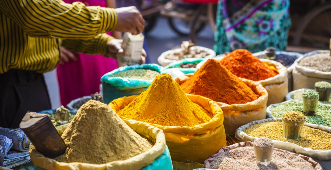 Spices in a traditional market in delhi india curiososhutterstock