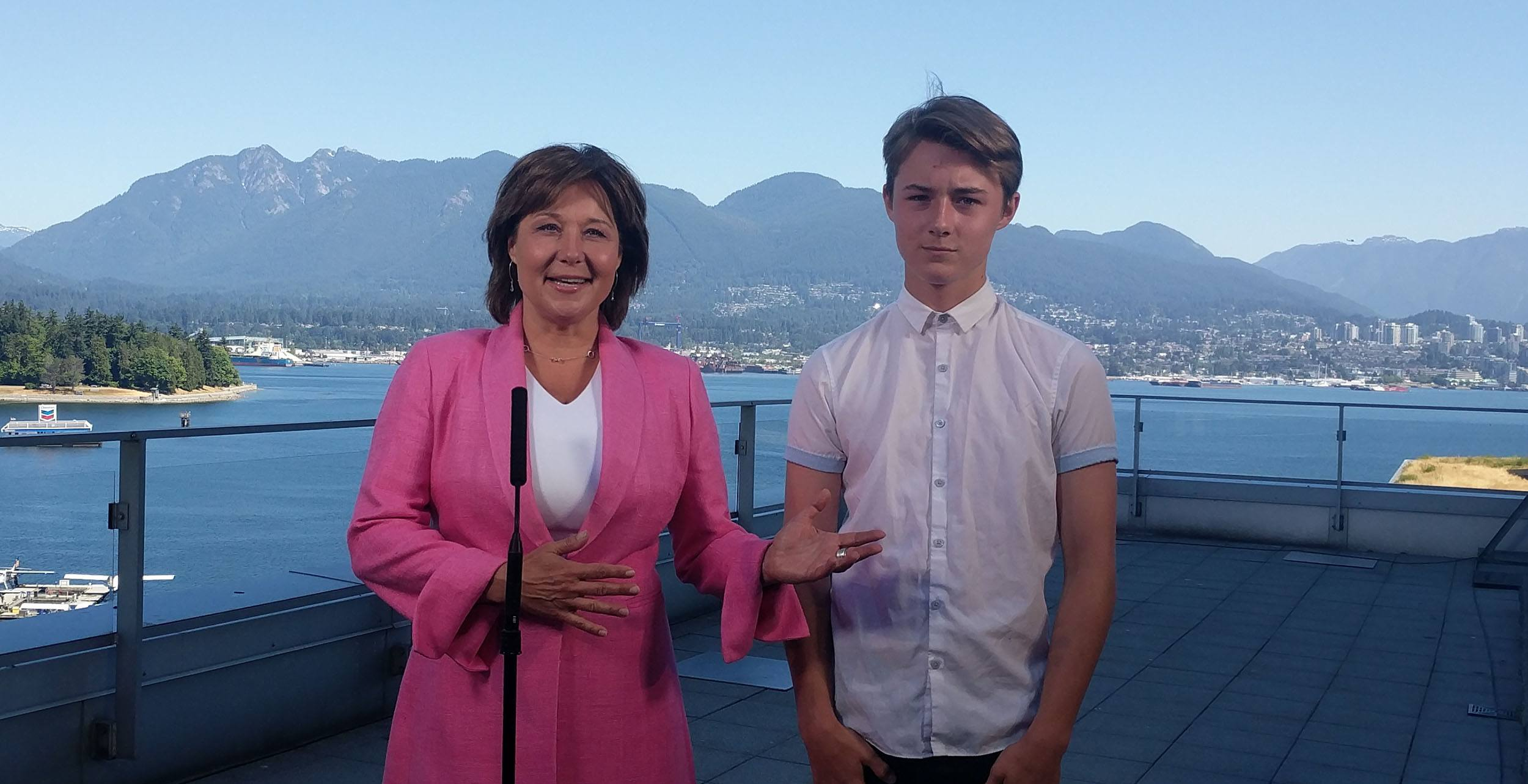 Christy clark and her son hamish at her farewell news conference jenni sheppard daily hive 2