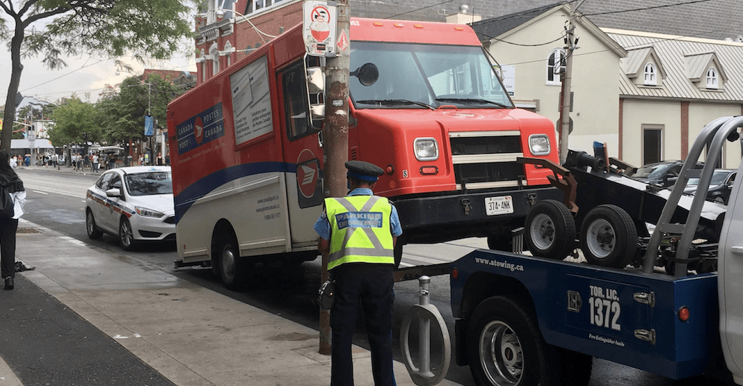 Canada Post truck gets towed the day Toronto Police announces its traffic campaign