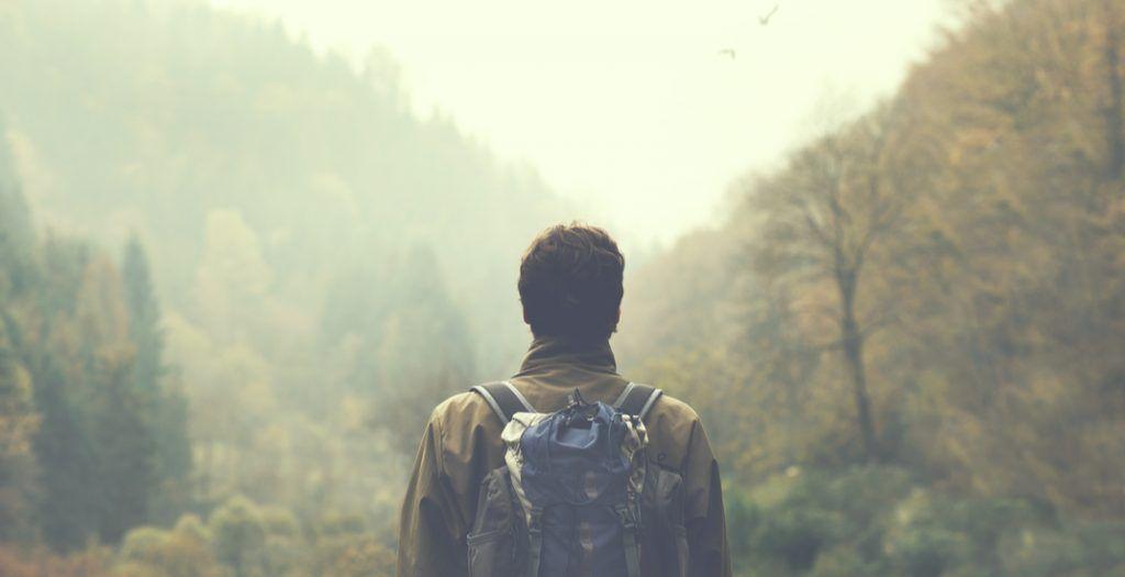 Man hiking in the mist (frankie's/Shutterstock)